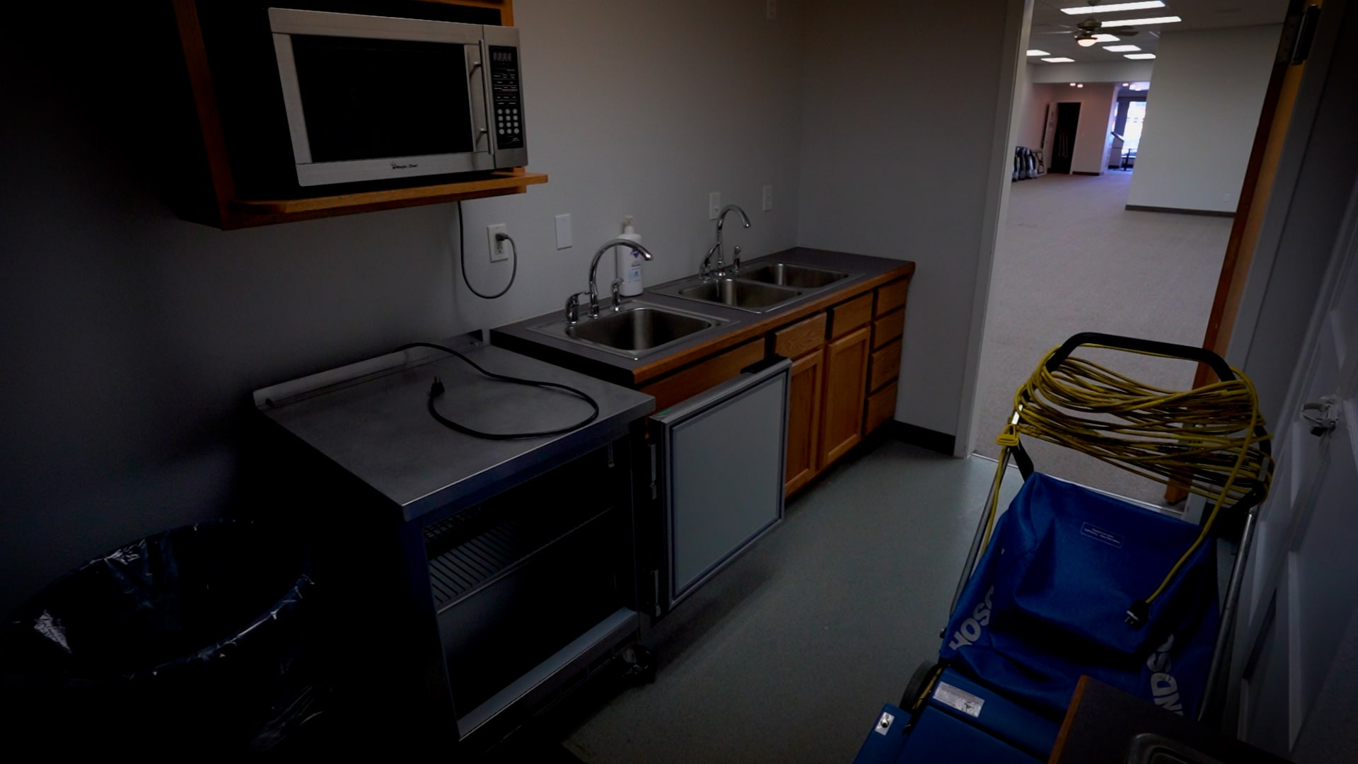 Kitchen with Microwave, Fridge, and Sinks in the Dille Center