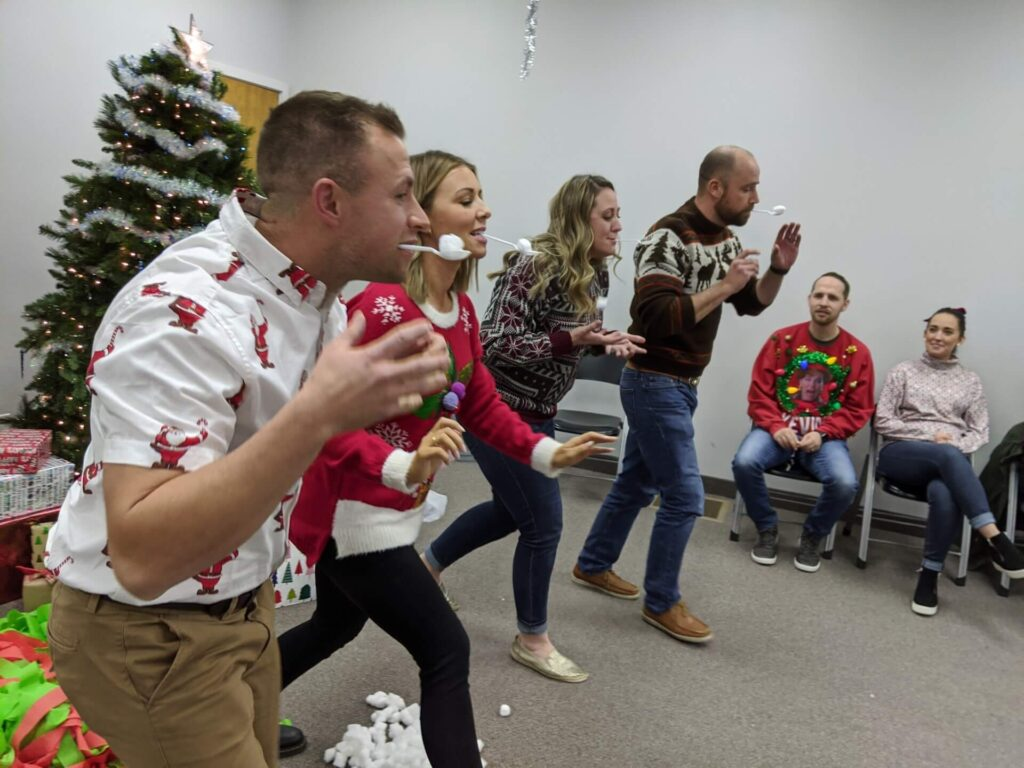 Adults Having Fun on a Marshmallow Challenge in a Christmas Party in Nampa, Idaho